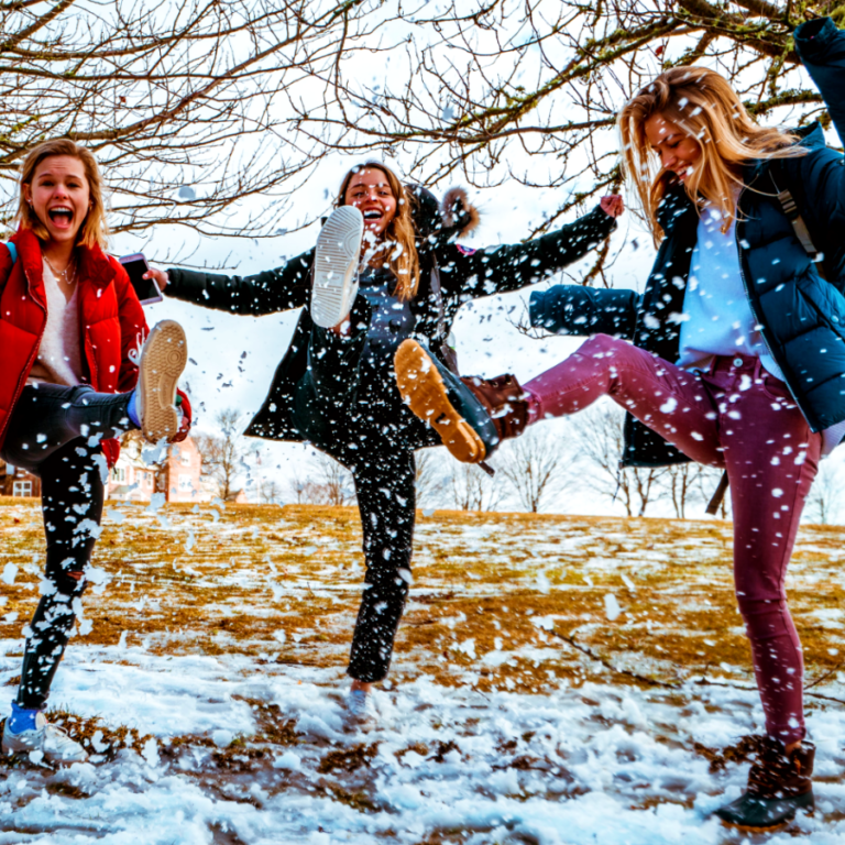 Women kicking snow