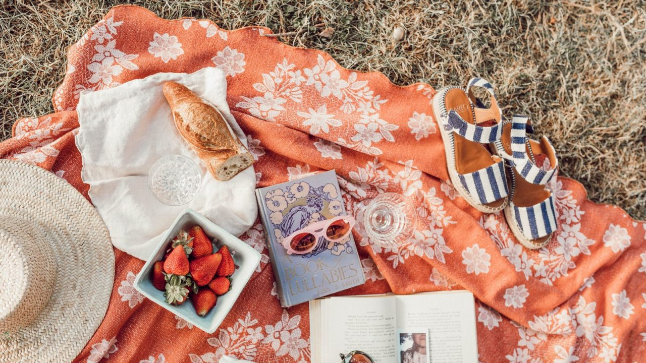 top angle photography of strawberries beside book photo